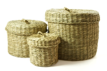 Set of three seagrass baskets isolated on a white background photo