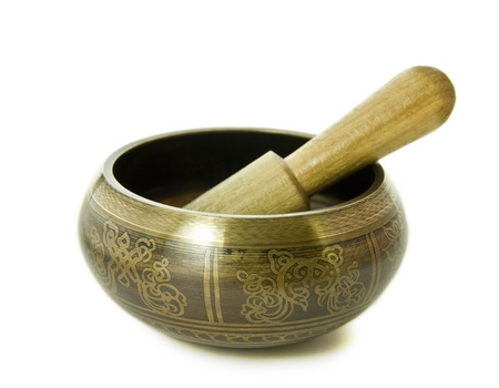 Tibetan singing bowl isolated on a white background photo
