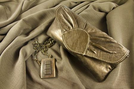 Elegant leather handbag and jewelry Stock Photo