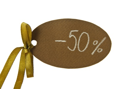 Discount tag with a ribbon isolated on a white background photo