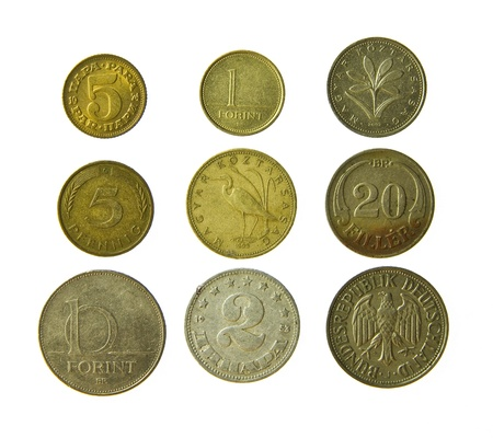 antique coins: Old metal coins isolated on a white background Stock Photo