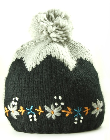 Old fashioned knitted winter woolen female cap Stock Photo