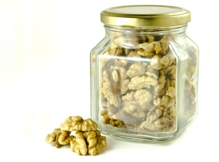 Walnuts in a glass jar photo