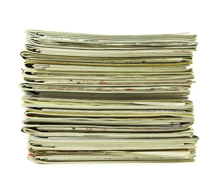 Stack of magazines isolated on a white background photo
