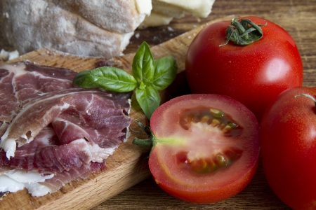 Food background with ham and tomatoes photo