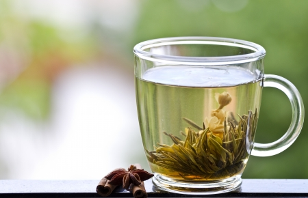 Cup of green tea with jasmine photo
