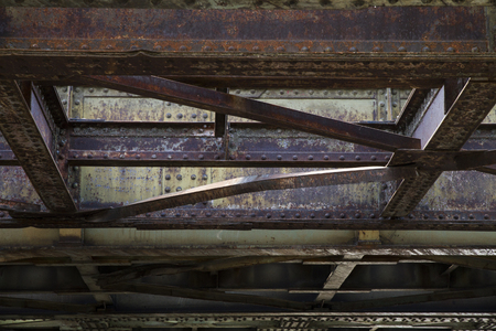 Aged, rusty steel rail construction.