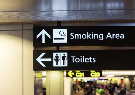 public restroom: Toilets icon. Public restroom signs l and smoking area. Interior of airport terminal. Stock Photo