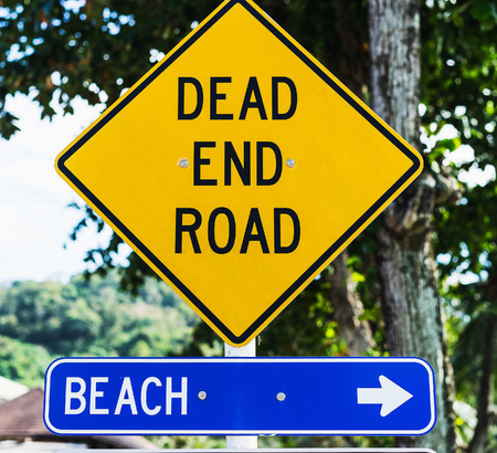 end of road: Two signs on the road: beach and dead end road Stock Photo