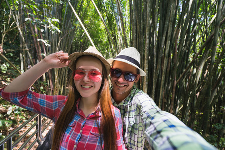 self discovery: Couple make selfie in jungle. Travel concept. Stock Photo