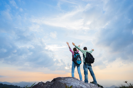 kao sok: Couple of hikers on the top of mountain. Travel concept