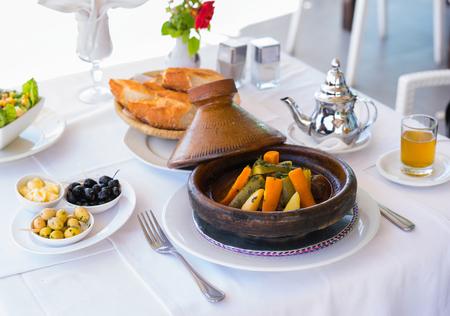 Moroccan dinner: tajine, olive, mint tea and bread.