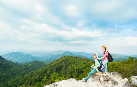 kao sok: Young backpackers enjoying a valley view from top of a mountain. Travel concept.