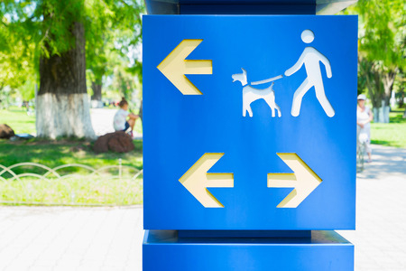 restricted area sign: Sign in park for walk with dog with directions.