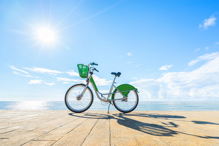 Bike with blue sky and sea background.