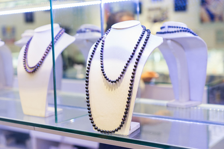 Jewellery shop. Necklace on sale maden from black  pearls. Close up shot. Selective focus.