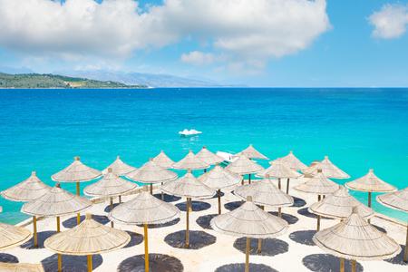 Sunshade umbrellas on the beautiful  beach.  Reklamní fotografie
