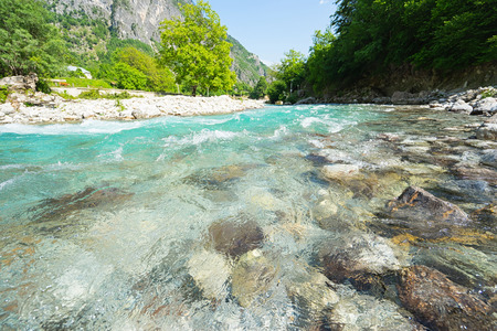 Mountain river with clean blue water. Selective focus. Reklamní fotografie