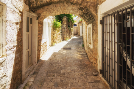 Narrow street with archway in the old town, Europe