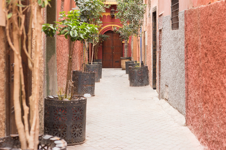 On the narrow street in medina at Marrakesh. Morocco. Focus on the door.
