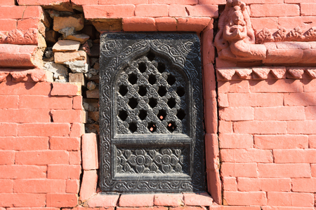 Old traditional Nepalese window with broken wall. Nepal, Kathmandu. Selective focus Reklamní fotografie - 88916905