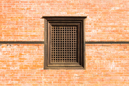 Old wooden traditional Nepalese window in brick wall. Nepal, Kathmandu. Reklamní fotografie