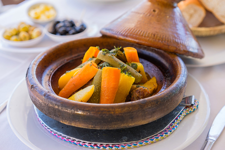 Close up moroccan food- tajine on the table. Selective focus Reklamní fotografie