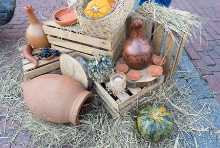 Traditional georgian wine jugs and hay Reklamní fotografie - 88916855