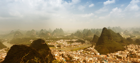 Air view on Yangshuo city with karst mountains around. Yangshuo, China. Banner