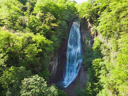 Makhuntseti (Mahuntseti) waterfall. Adjara. Georgia. Aerial view. Water in motion blur. Standard-Bild