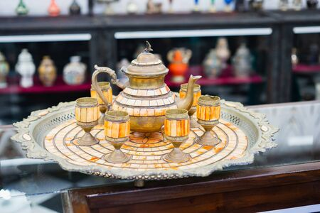 Old traditional arabian teapot and glasses on tray. Selective focus. Standard-Bild