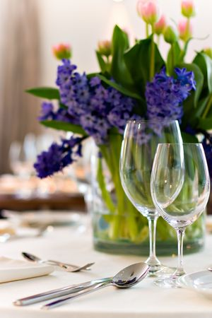 Served restaurant table ready for wedding or event, with bouquet, violet and pink flowers Stock Photo - 667401