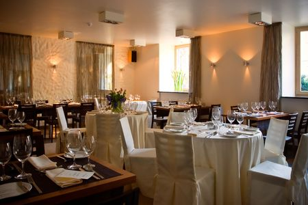 fine silver: Restaurant interior with served tables Stock Photo