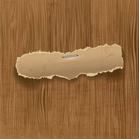 plied: Torn paper on wooden background with place for your message