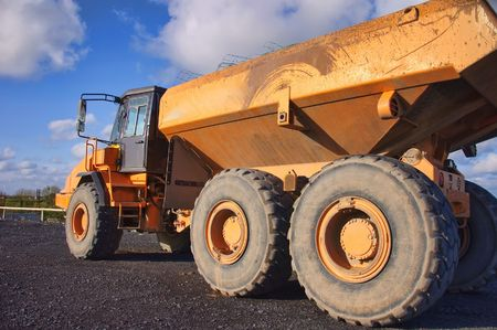 overburden: large yellow industrial heavy earth loader outside
