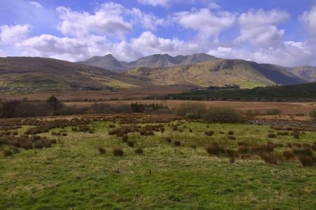 achill: vibrant landscape mountains and forest with blue sky clouds