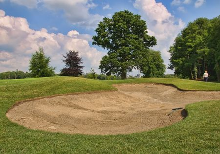 par: golf sand bunker in scenic location trees and blue sky Stock Photo