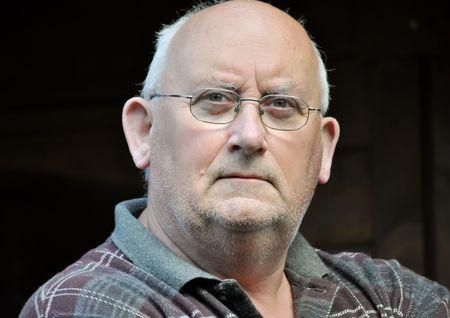 portrait of an older unshaven male natural light Stock Photo - 5275521