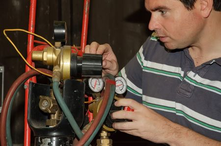 picture of male adjusting a welding gas mix photo
