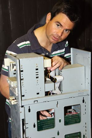 techie: picture of male working on fixing a server computer Stock Photo