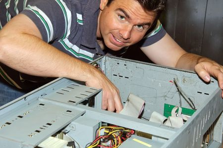 picture of male working on fixing old pc server Stock Photo - 5315188