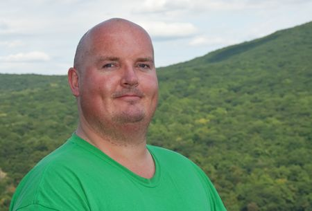 overweight male after hike up a forest mountain Stock Photo - 5489180