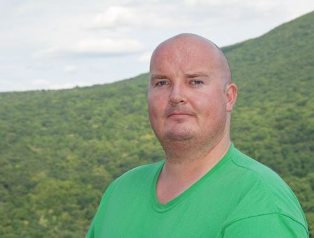 overweight male sweating after mountain hike photo