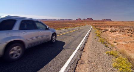 navajo land: SUV car entering monument valley, utah Stock Photo