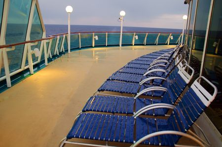 photo lounge chairs in a row on a ocean cruise ship photo