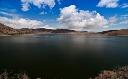 photo of a scenic landscape with lake and mountains Stock Photo - 6044880