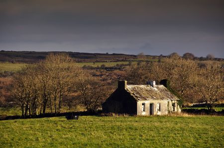 photo of decay cottage in rural ireland countryside photo
