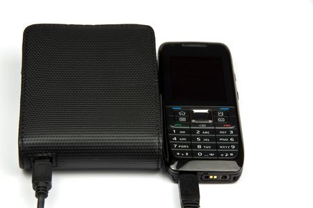 photo of mobile phone connected to external hard drive Stock Photo - 6123791