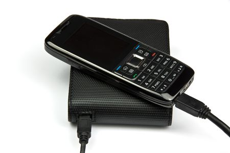 harddisc: photo of mobile phone connected to external hard drive