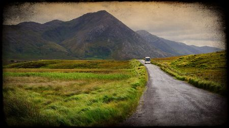 irish countryside: photo grunge texture of a scenic irish nature landscape with tourist bus